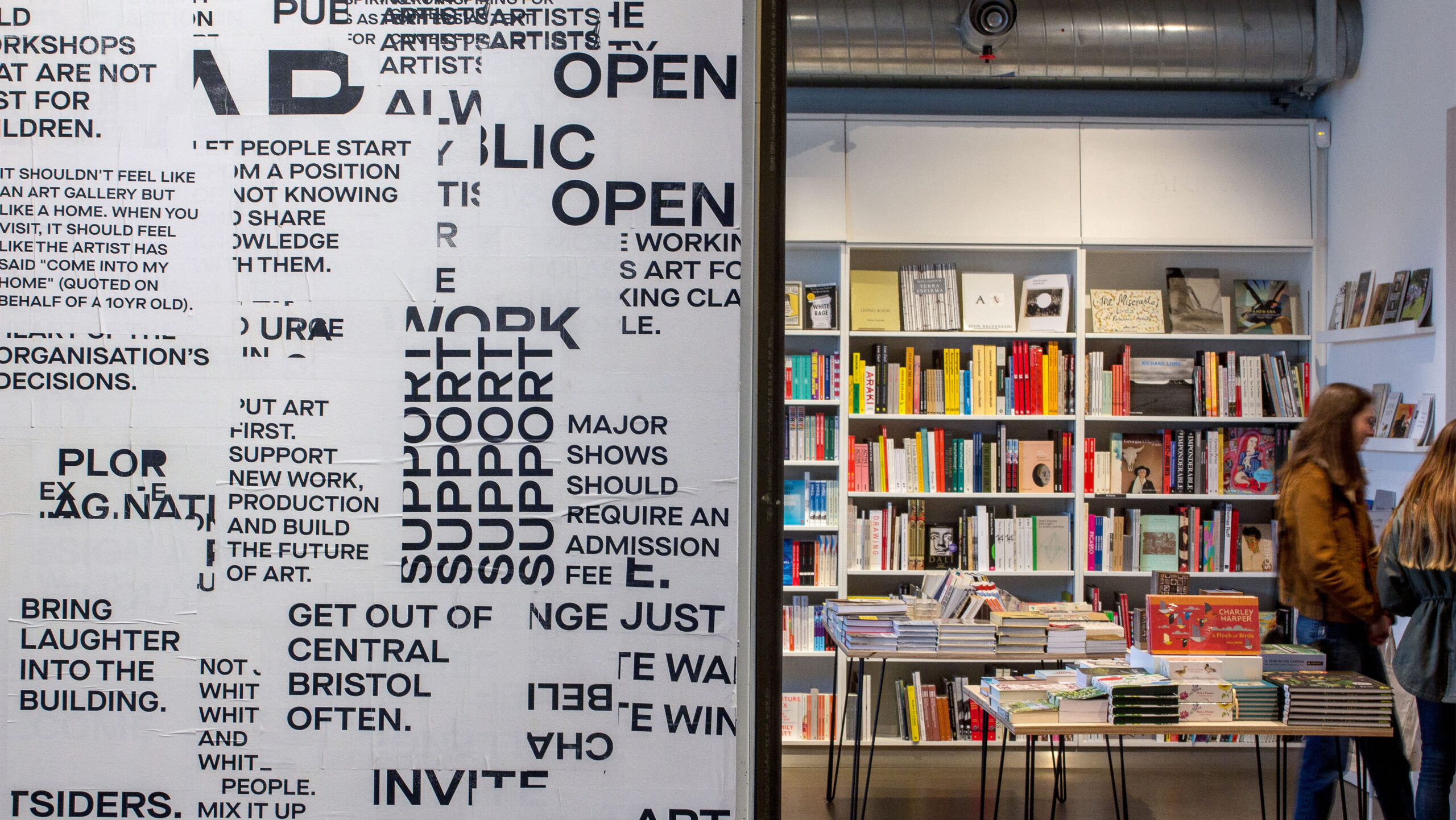 A photograph of a wall featuring a typographic installation at Arnolfini gallery designed by City Edition Studio as part of Smith and Lewarne