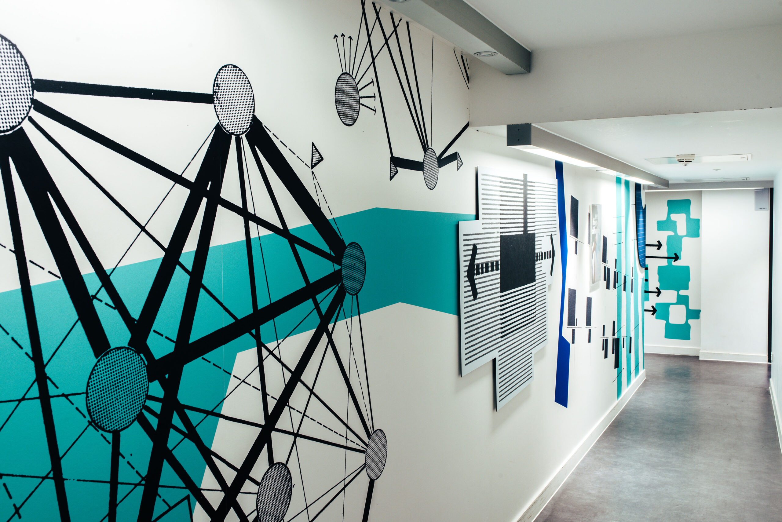 A photograph of a wall featuring a graphic installation at The Edge at the University of Bath designed by City Edition Studio as part of Smith and Lewarne